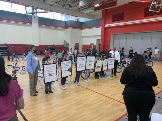 Cottonwood students are displaying sponsors of the bikes at the big unveiling party.