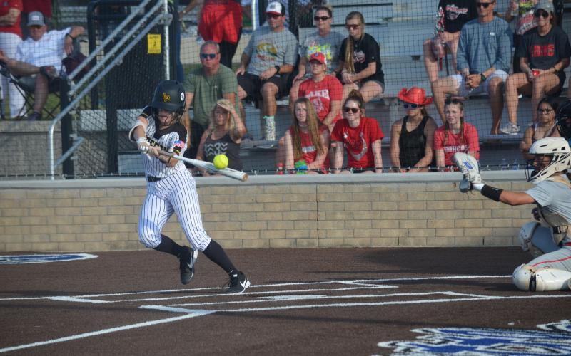 Reese Evans of Liberty fouls off a pitch in Navasota on Thursday night against Lake Belton in game one of the Class 4-A Regional Finals.