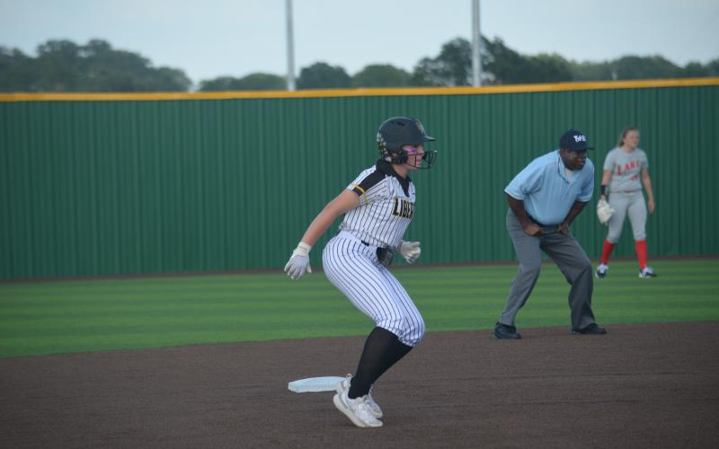 Liberty's Jaylen Prichard leads off of second base on Thursday night in game one against Lake Belton.