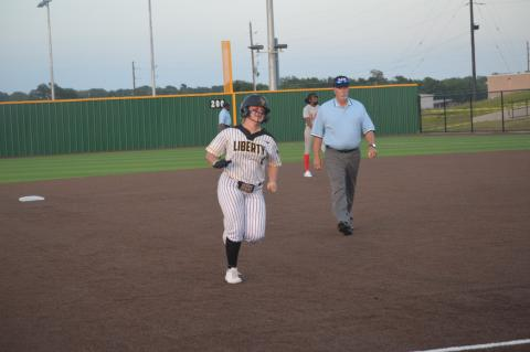 Liberty's Kamdyn Chandler rounds the bases after her game-tying home run in the sixth inning during game one against Lake Belton.